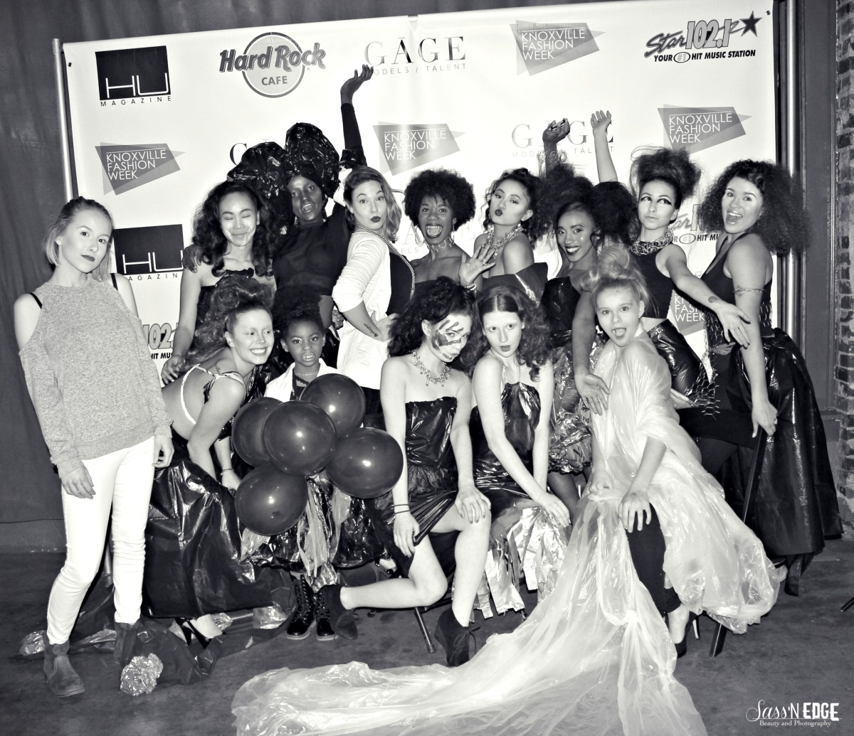 Models and designers from trash bag collection show posing for a group picture at the trash collection show.