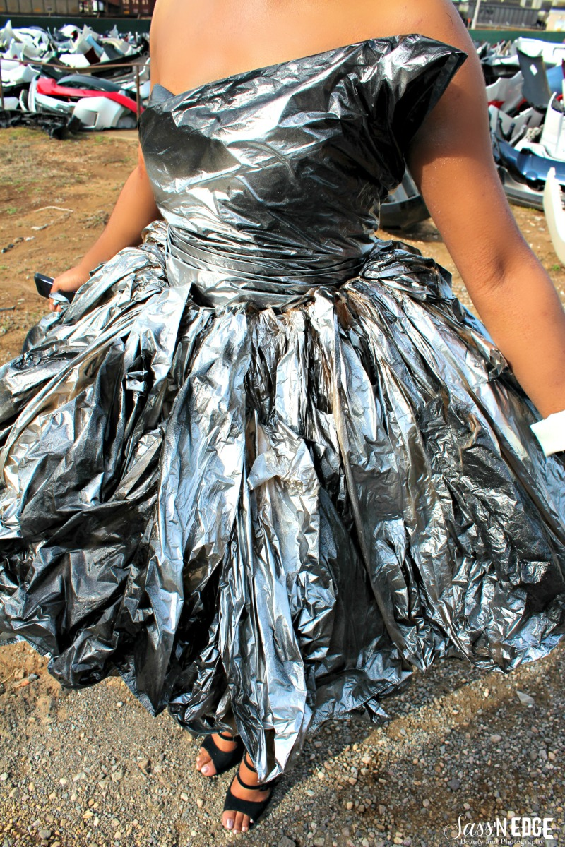 Closeup of a model's trashbag dress.