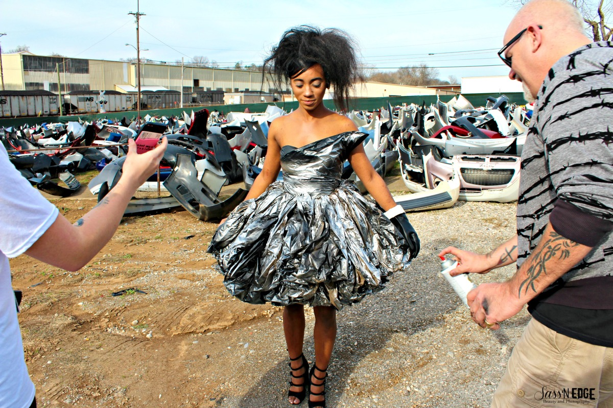 McNally spraing model's trash bag dress on site of the trash collection shoot.