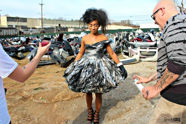 McNally spraing model's trash bag dress on site of the trash collection shoot.